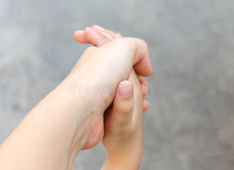 Adult Holding on to the Hand of a Child stock photos