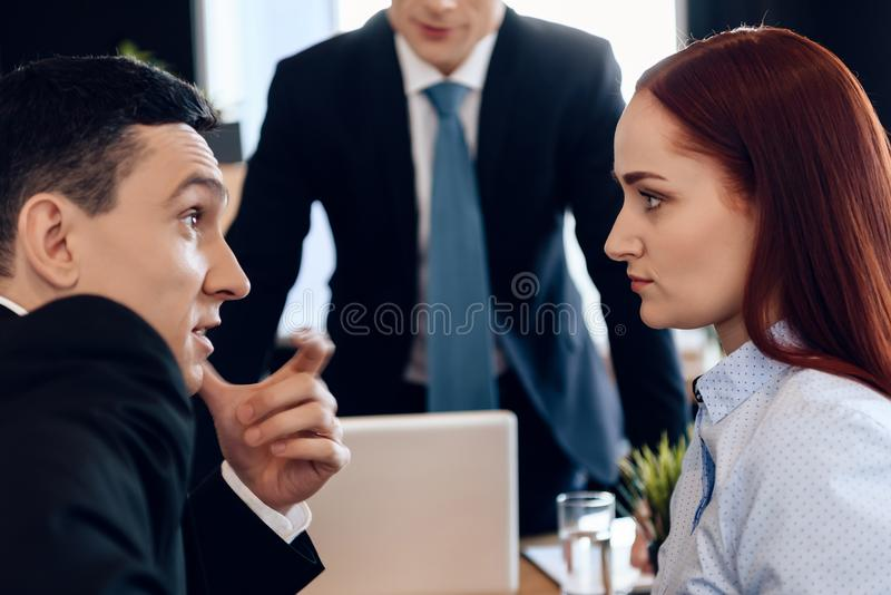 Adult husband and wife discuss dissolution of marriage in attorney office. royalty free stock image