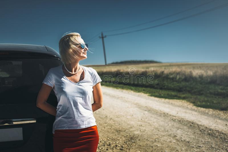 Adult independent woman enjoys road adventure. Successful woman freedom holidays concept. Vacation, motivation concept. Adult independent woman enjoys road royalty free stock images