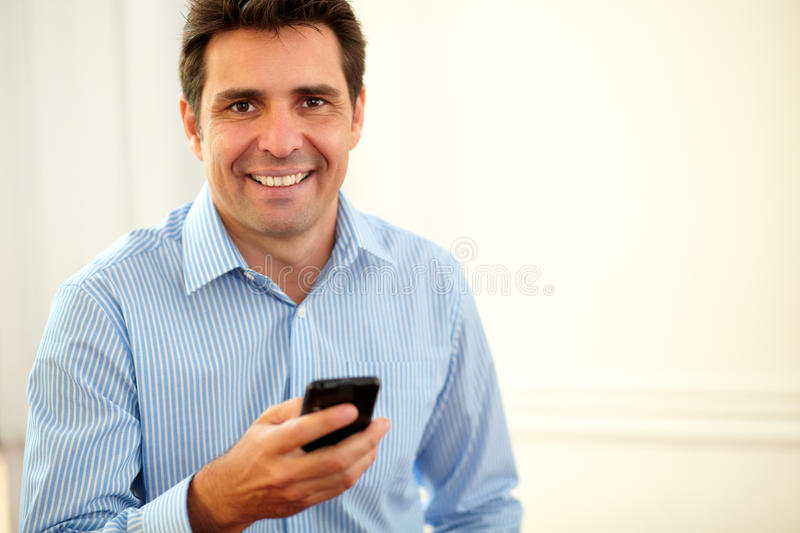 Adult latin businessman smiling at you royalty free stock photography