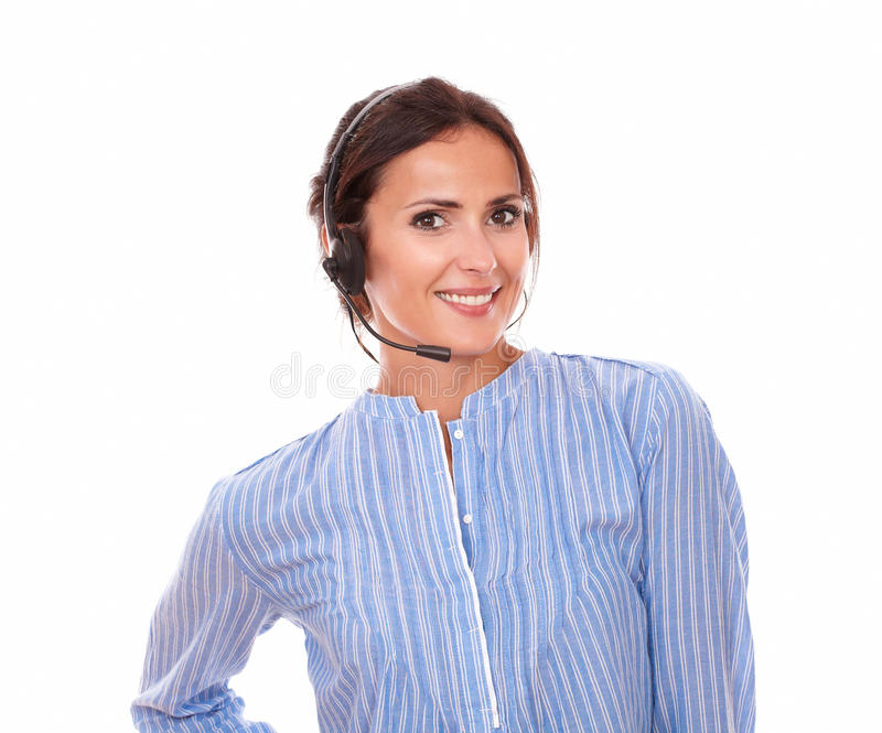Adult latin female conversing with earphone stock image