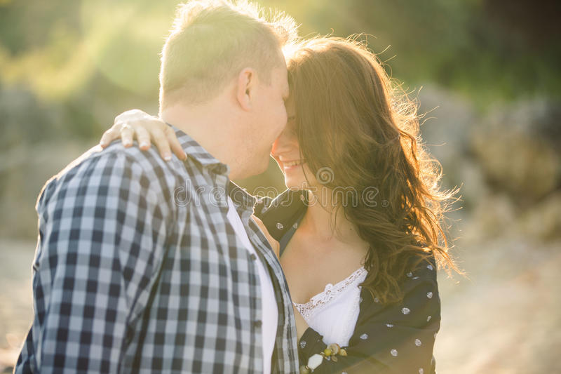 Adult loving couple on the beach. Adult men and women dressed in Boho style on the beach royalty free stock photos