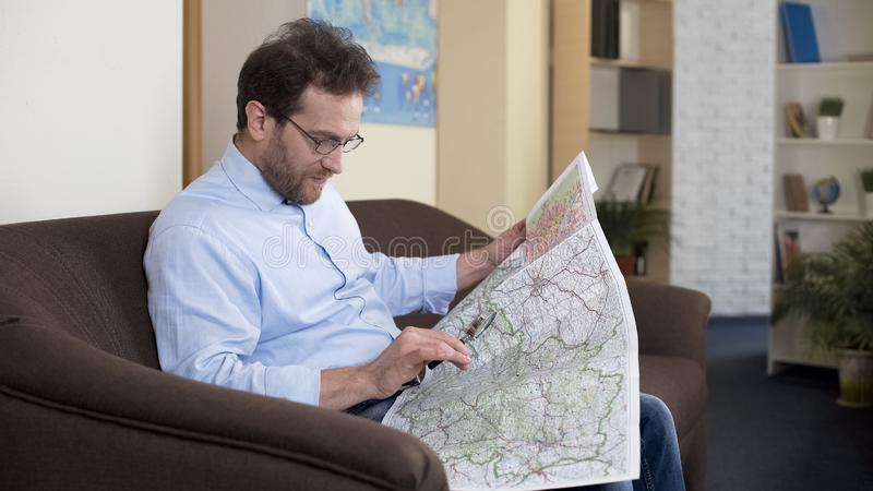 Adult male looking at map, planning trip, vacation and traveling, tourism stock photos