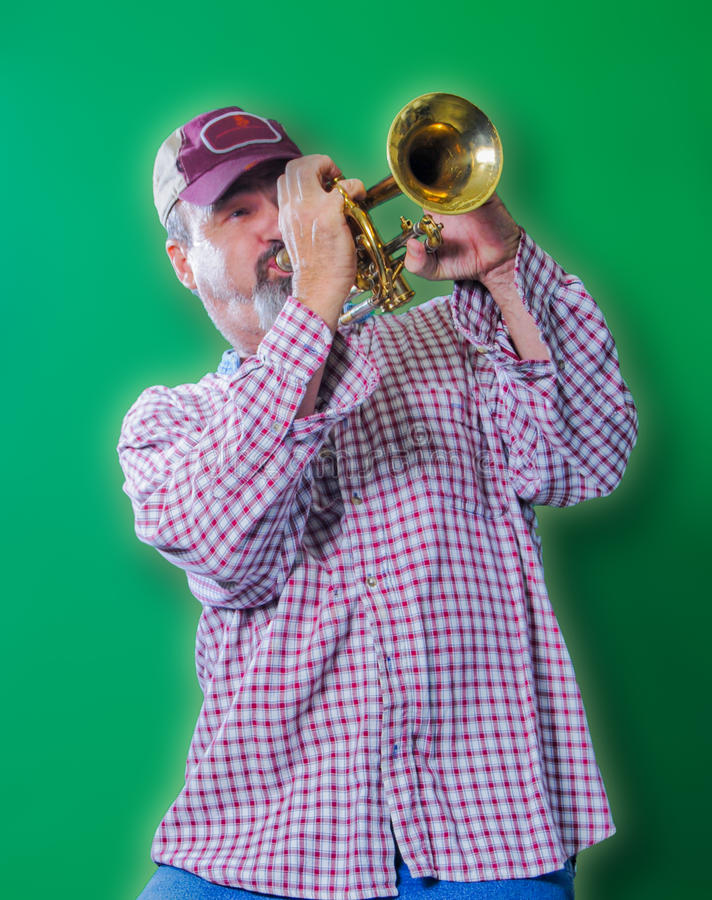 Adult male playing blues on a trumpet royalty free stock photo