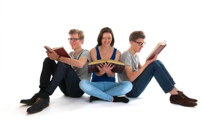 Adult male twins and young girl reading books. Identically adult male twins with girl reading books in studio stock photos