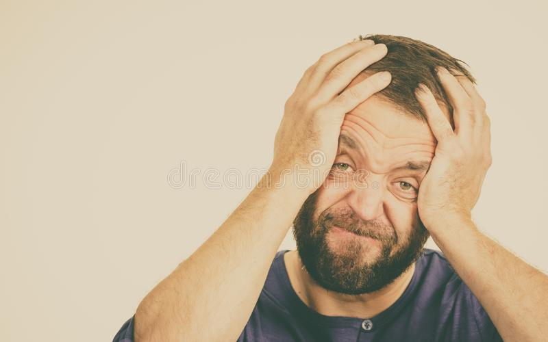 Worried man gesturing with hands royalty free stock image