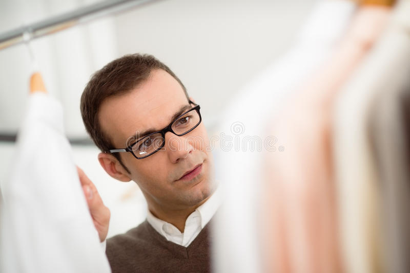 Adult Man Choosing Shirt In Clothes Shop Royalty Free Stock Photos