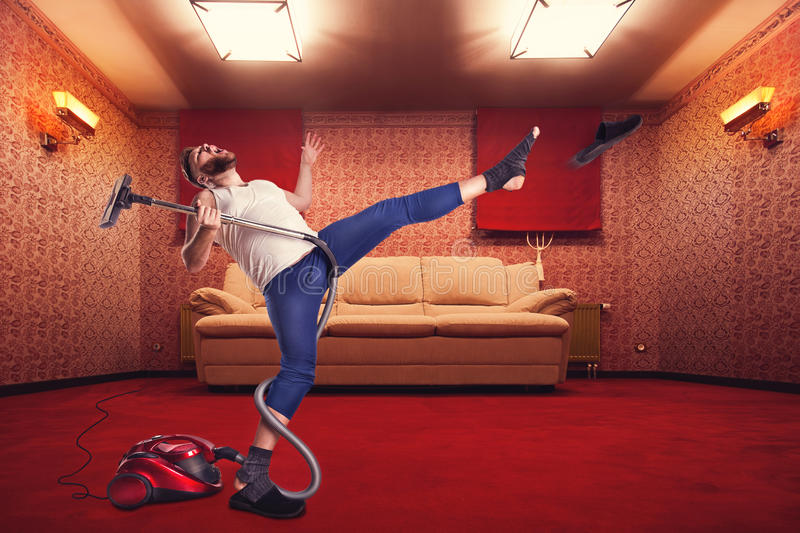 Adult man dancing withvacuum cleaner royalty free stock images