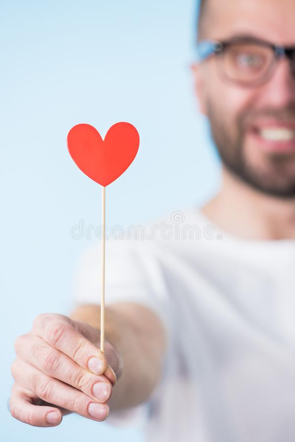 Adult man with heart on stick royalty free stock images