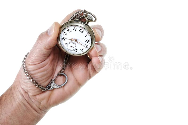 Adult man holding an antique pocket watch in his hand. Observe the passage of time with an antique pocket watch on a white background stock images