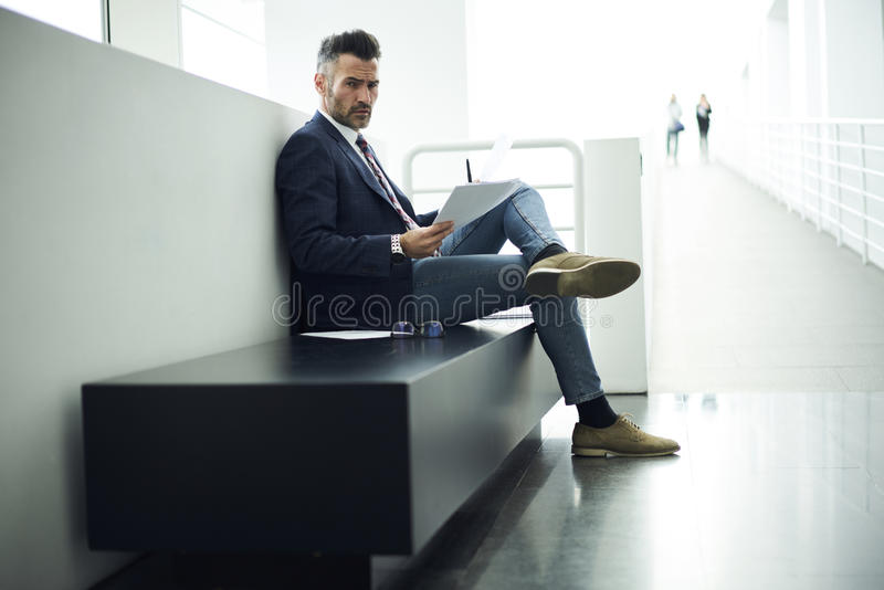 Adult man in a jacket and glasses meeting with executive trying to share impression with readers stock photos