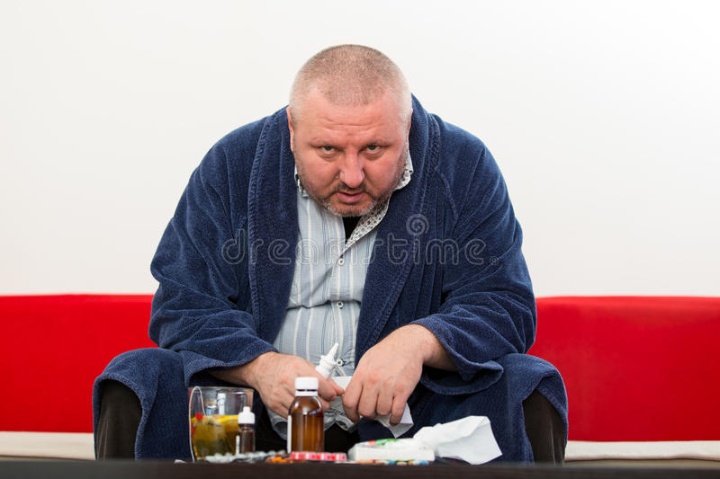 Adult man patient with cold and flu illness relief.  royalty free stock photography
