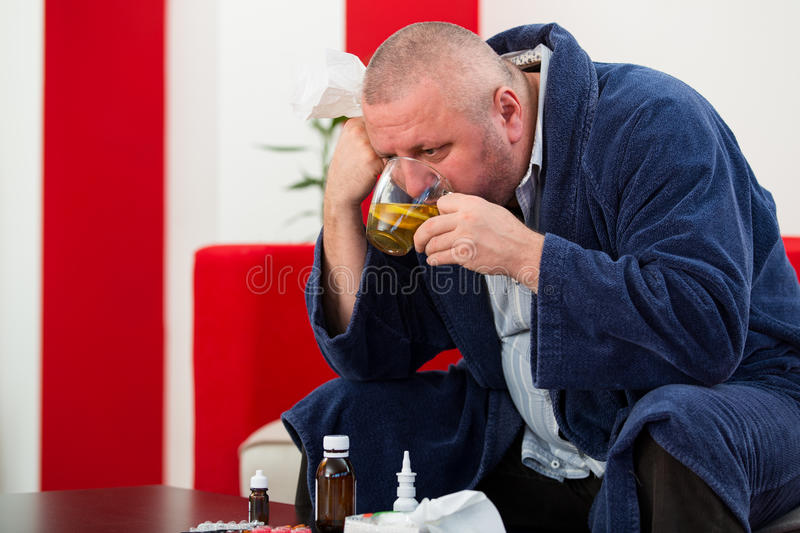 Adult man patient with cold and flu illness relief.  stock photos