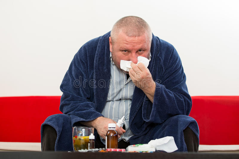 Adult man patient with cold and flu illness relief.  royalty free stock images