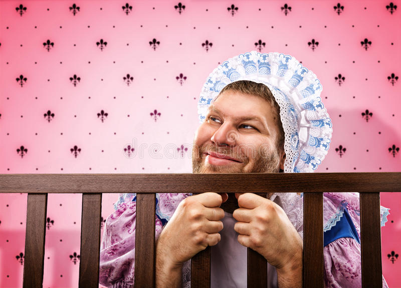 Adult man in playpen looking out stock photos