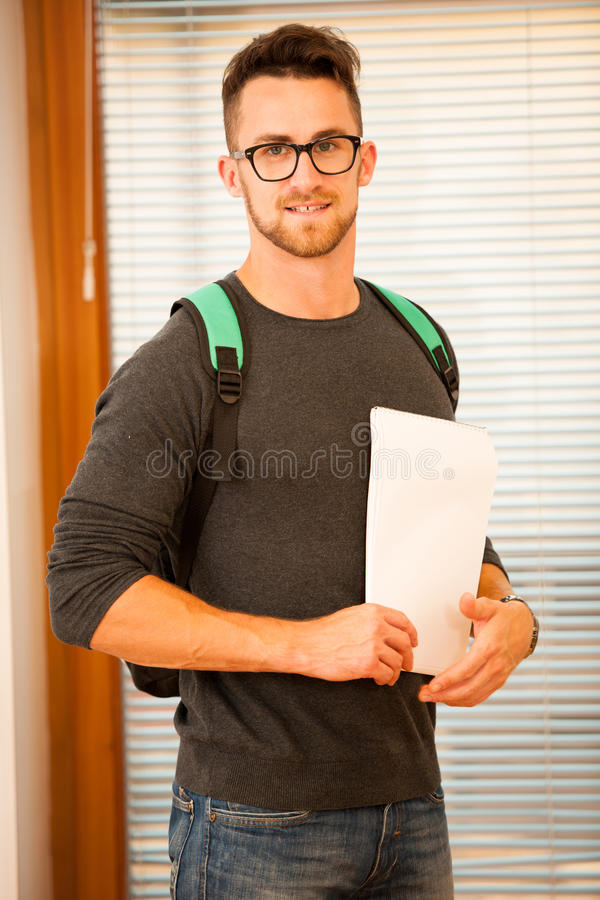 Adult man representing lifelong learning. Man with school bag sh. Owing thumb up as a gesture of happiness and joy to study royalty free stock images