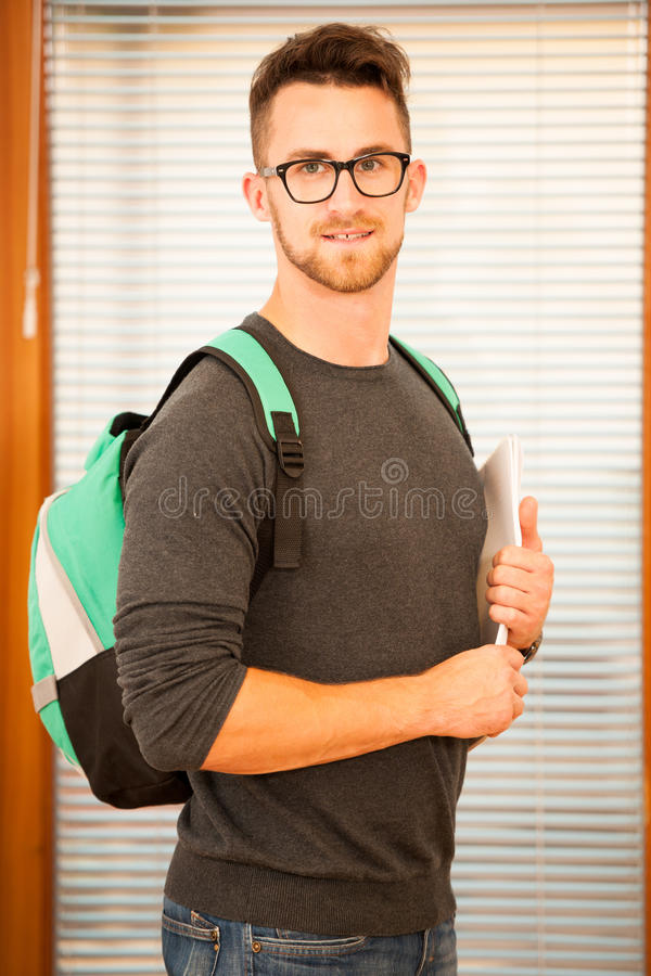 Adult man representing lifelong learning. Man with school bag sh. Owing thumb up as a gesture of happiness and joy to study stock photos