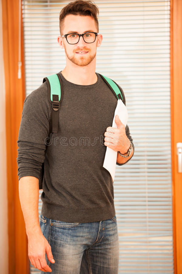 Adult man representing lifelong learning. Man with school bag sh. Owing thumb up as a gesture of happiness and joy to study stock image