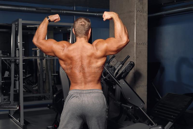 Adult man shows his athletic, inflated body. stock photos