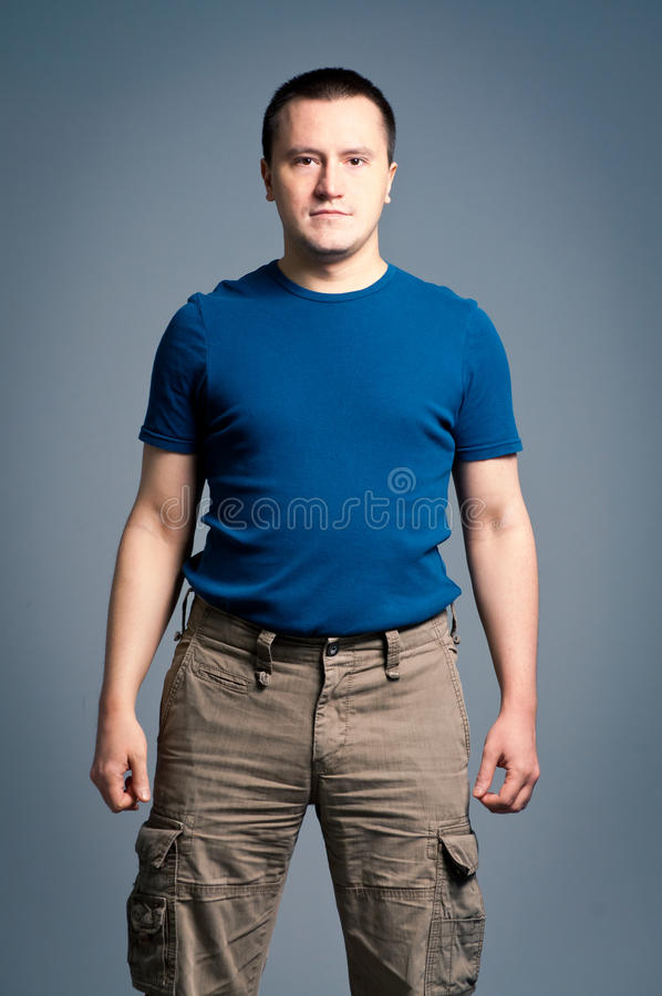 Download Adult Man Standing With A Smirk Stock Image - Image of blue, young: 20065585
