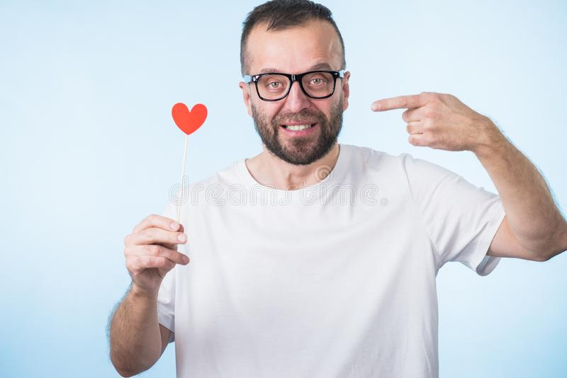 Adult man with heart on stick stock photos