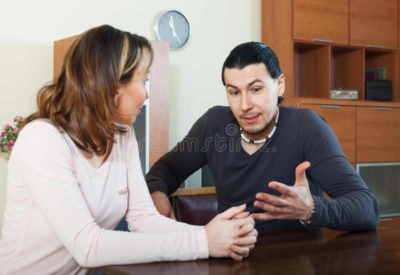 Adult man with wife talking. Adult men with wife talking in home interior royalty free stock images