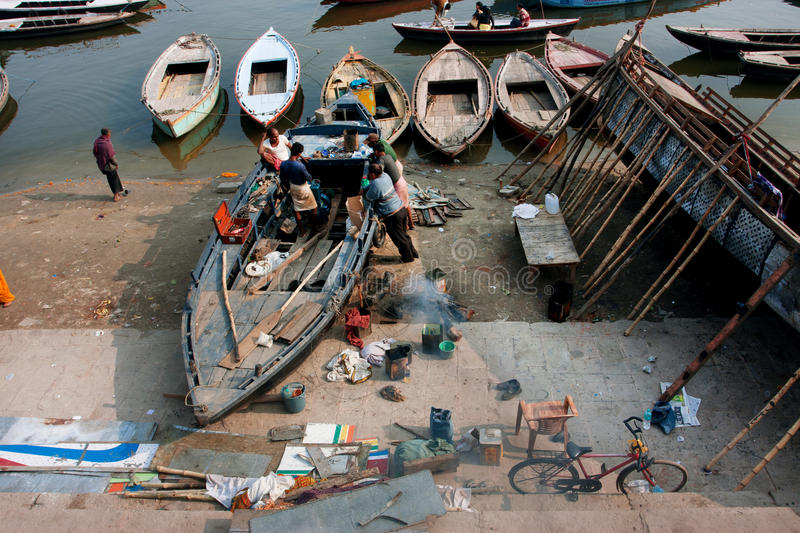 Adult men fix a motor of an old river boat royalty free stock images