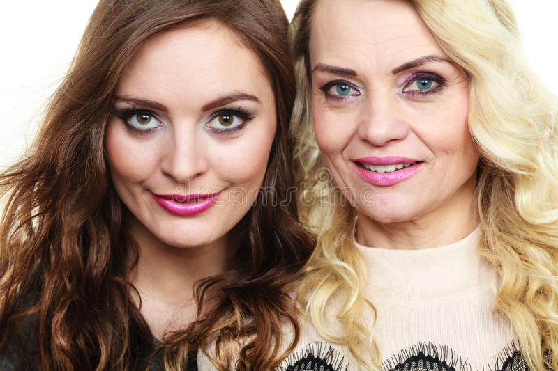 Adult mother and daughter portrait royalty free stock photos