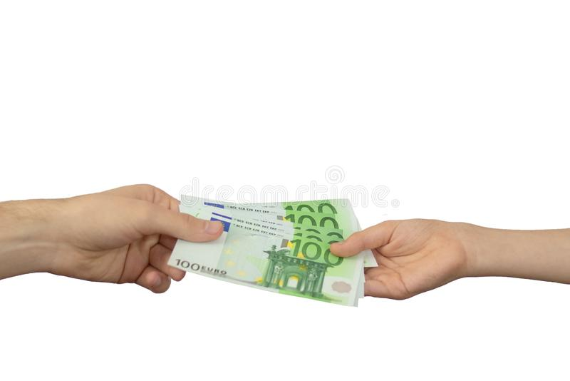An adult pays a child paper money. The concept of inheritance transfer or payment for minor labor. European currency in denominati stock photography