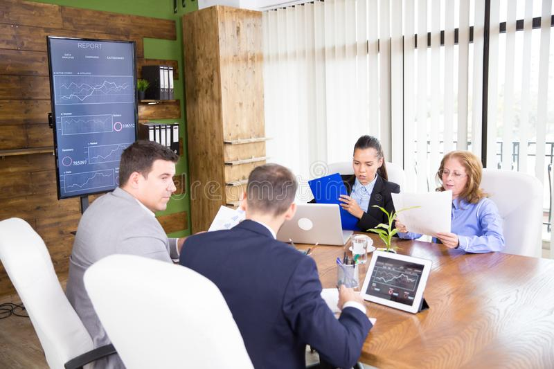 Adult people working productively on business project together stock photography