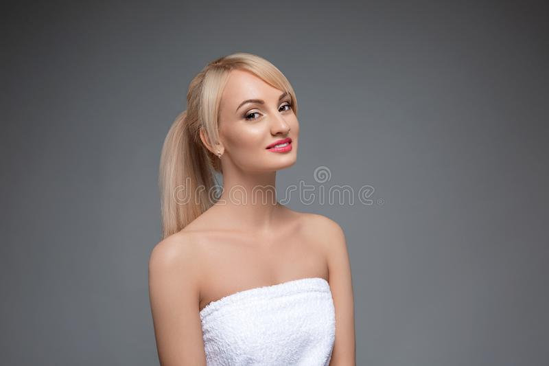 Adult portrait of a woman, concept of skin care, beautiful skin. Portrait of a girl on a gray neutral background. beauty royalty free stock images