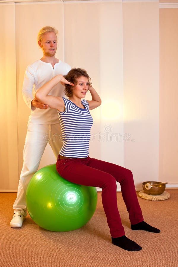 Adult practicing poses on exercise ball royalty free stock photo