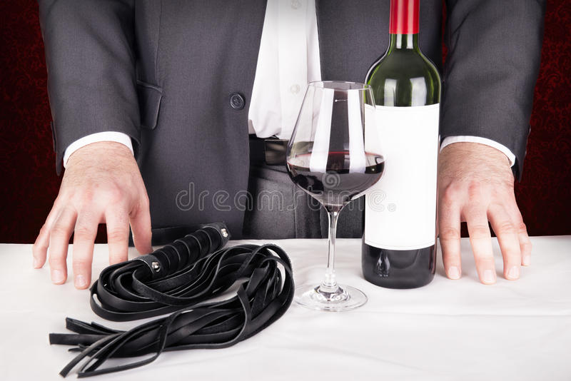 Adult role playing game concept. Elegant man proposing a role playing game royalty free stock photo