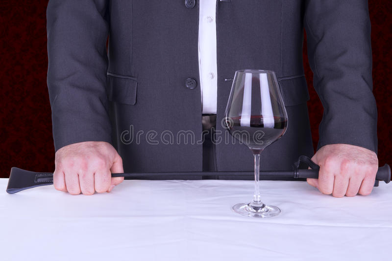 Adult role playing game concept. Elegant man proposing a role playing game royalty free stock photography