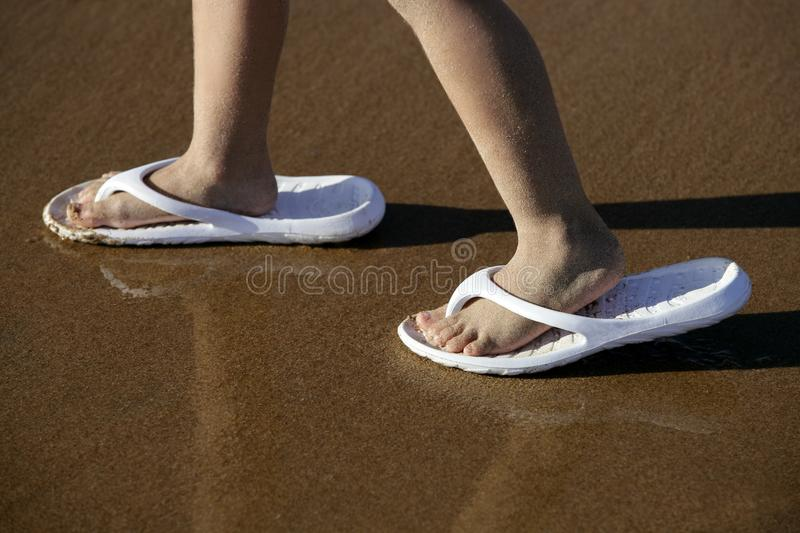 Download Adult Shoes For Children Feet On Beach Sand Stock Photo - Image: 11487242