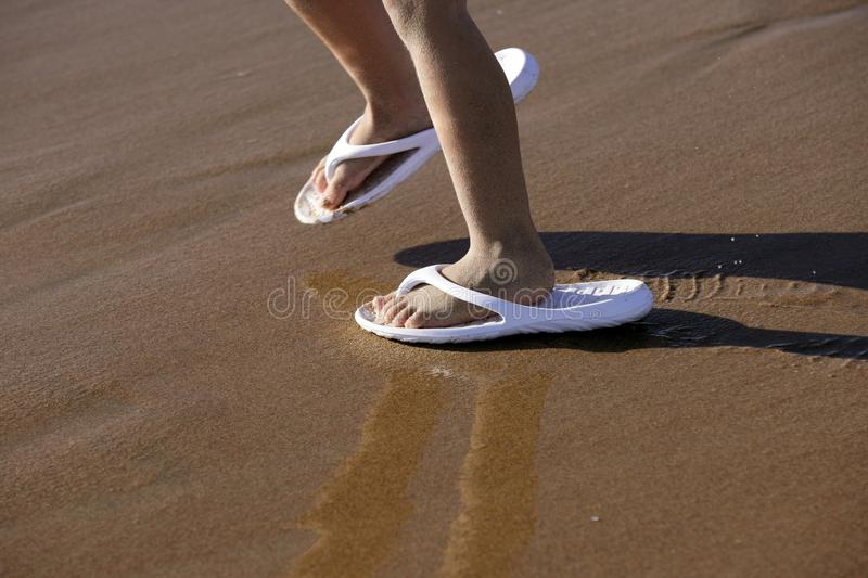 Download Adult Shoes For Children Feet On Beach Sand Stock Photo - Image of caucasian, background: 11691938