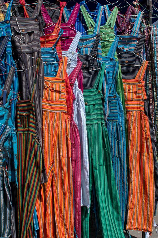Adult sized coveralls. Hanging at a vendor`s stall in the artisan`s market in Otavalo, Ecuador royalty free stock photography