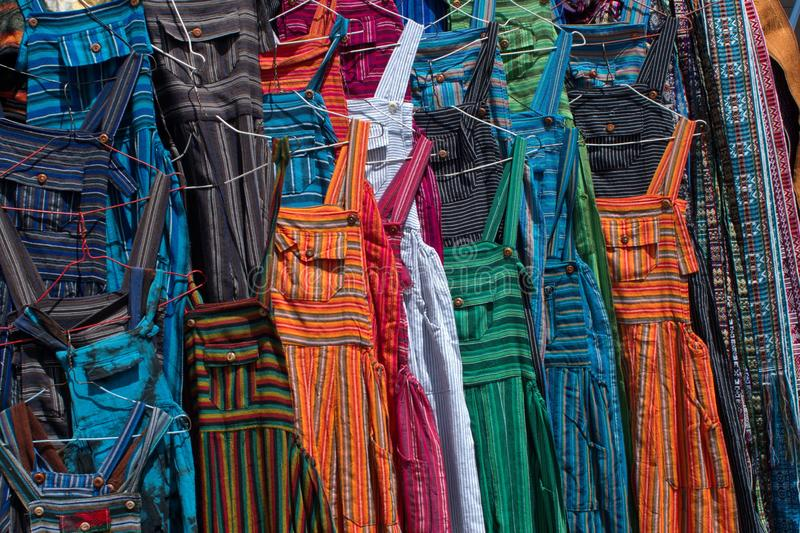 Adult sized coveralls. Hanging at a vendor`s stall in the artisan`s market in Otavalo, Ecuador stock photo