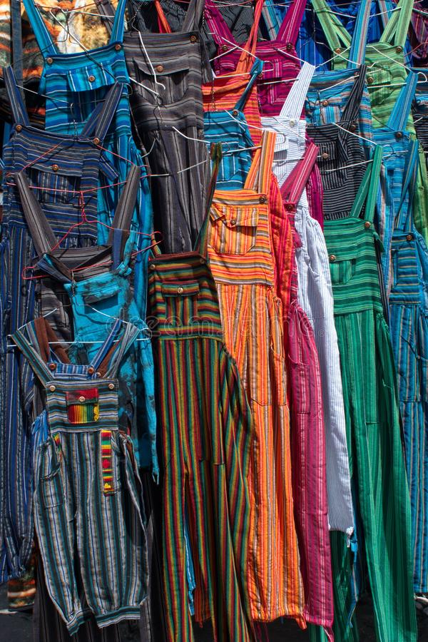 Adult sized coveralls. Hanging at a vendor`s stall in the artisan`s market in Otavalo, Ecuador stock photography
