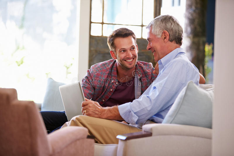 Adult Son Helping Senior Father With Computer At Home royalty free stock photos