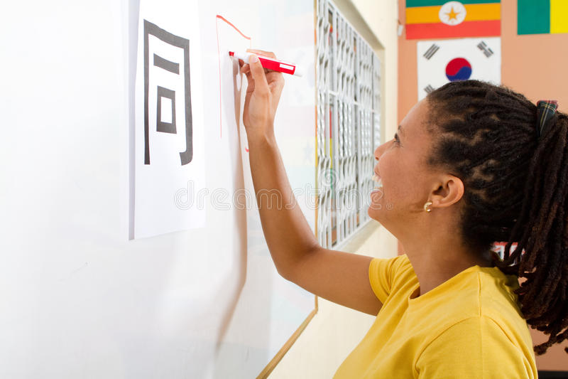 Adult student. An adult african student learning to write chinese characters in classroom stock image