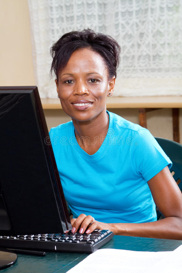 Adult student. Mid age african american adult student learning computer royalty free stock photo