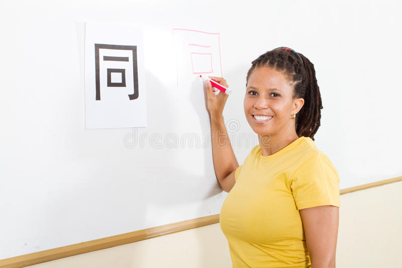 Adult student learning chinese. Happy adult student learning chinese in classroom stock image