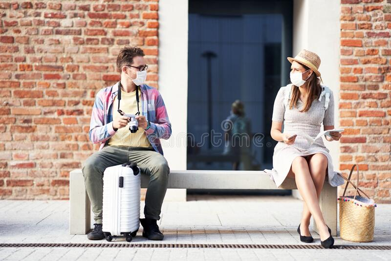 Adult tourists in masks sightseeing Gdansk Poland royalty free stock photo