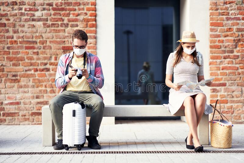 Adult tourists in masks sightseeing Gdansk Poland royalty free stock image