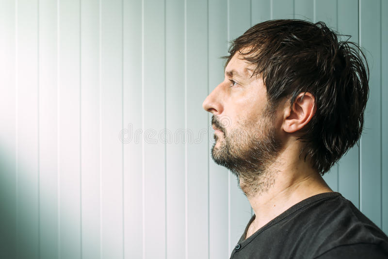 Adult unshaven casual male profile portrait with copy space stock image