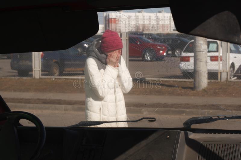 Upset young woman after a car accident stock images