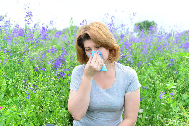 Adult woman with allergies on the Meadow. An adult woman with allergies on the Meadow stock photo