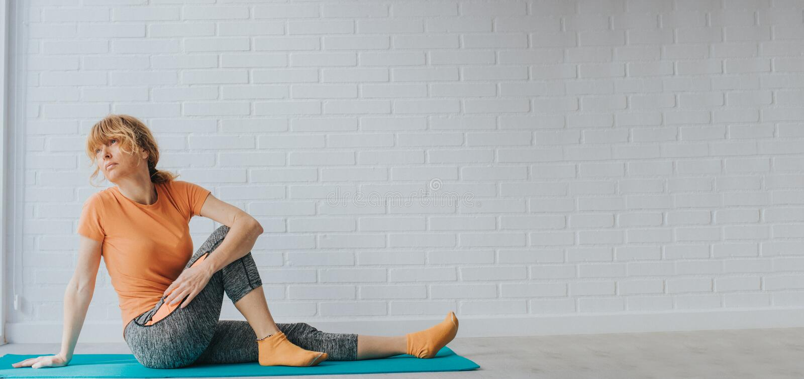 Adult woman doing sports or gymnastics at home stock photos