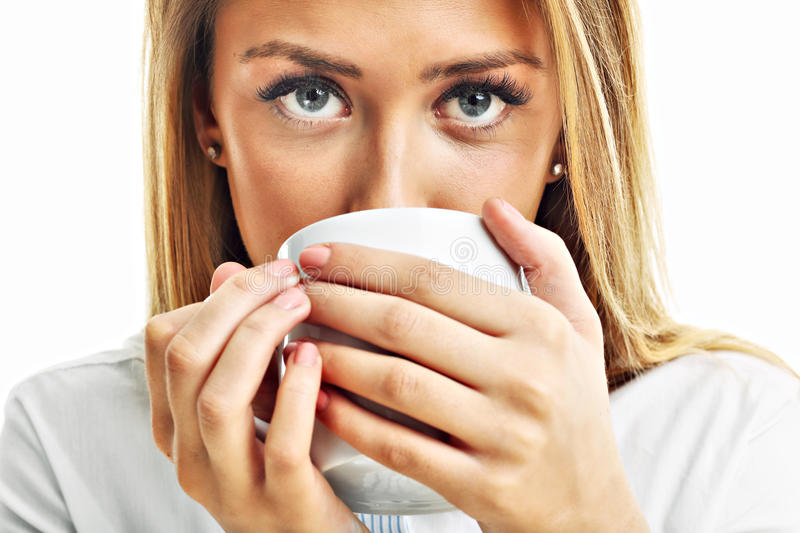 Adult woman drinking cup of tea coffee isolated over white. Picture of adult woman drinking cup of tea coffee isolated over white stock images